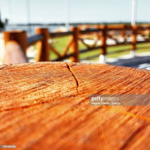 Close-Up Of Wooden Post Against Sea