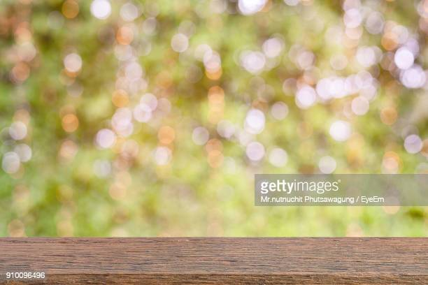 close-up of wooden railing against defocused sunlight - railing stock pictures, royalty-free photos & images