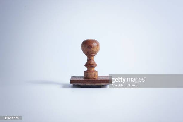 close-up of wooden rubber stamp against white background - timbro foto e immagini stock