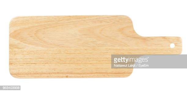close-up of wooden serving board over white background - cutting board stock pictures, royalty-free photos & images