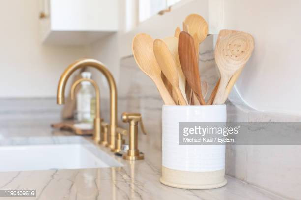 close-up of wooden spoons in container on kitchen - kaal stock pictures, royalty-free photos & images