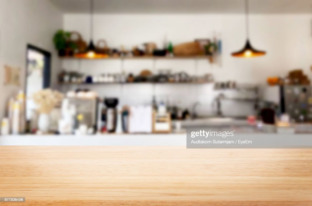 Close-Up Of Wooden Table Against Kitchen : Stock Photo