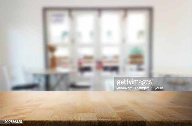 close-up of wooden table at home - wood material stock pictures, royalty-free photos & images