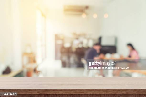 close-up of wooden table at home - incidental people stock pictures, royalty-free photos & images