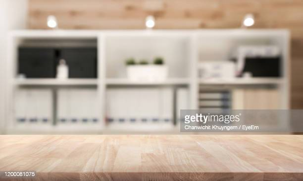 close-up of wooden table at home - legno foto e immagini stock