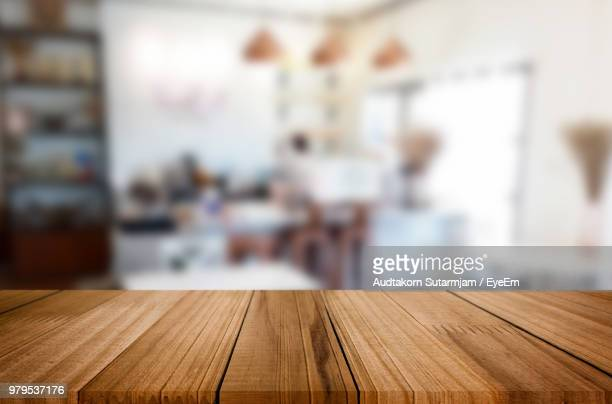 close-up of wooden table at home - tafel stockfoto's en -beelden