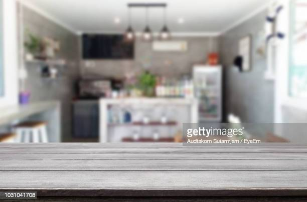 Close-Up Of Wooden Table In Cafe