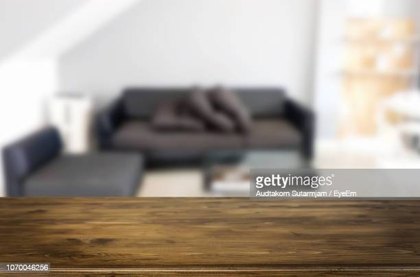close-up of wooden table in living room at home - 後ろボケ ストックフォトと画像