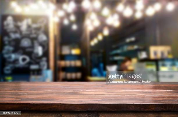 close-up of wooden table in workshop - table stock pictures, royalty-free photos & images