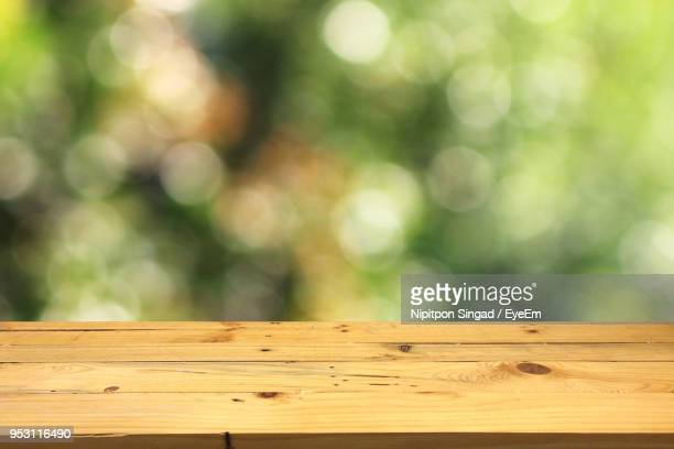 close-up of wooden table - focus on foreground stock pictures, royalty-free photos & images