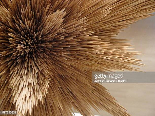 Close-Up Of Wooden Toothpicks On Table