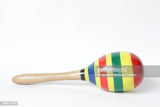 Close-Up Of Wooden Toy Rattle Over White Background