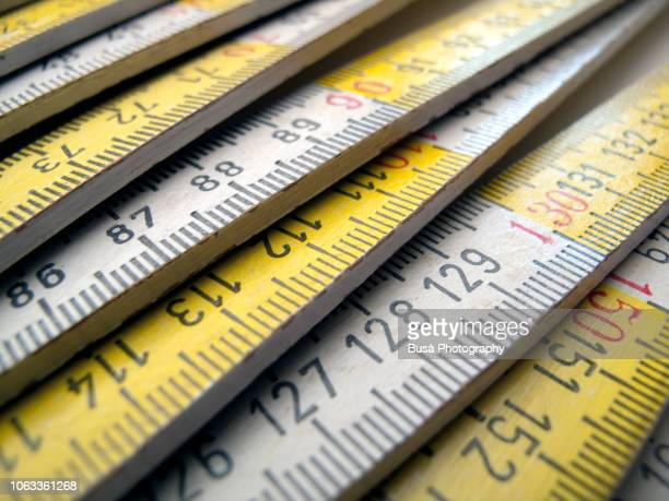 close-up of wooden white and yellow ruler - meter unit of length stock pictures, royalty-free photos & images