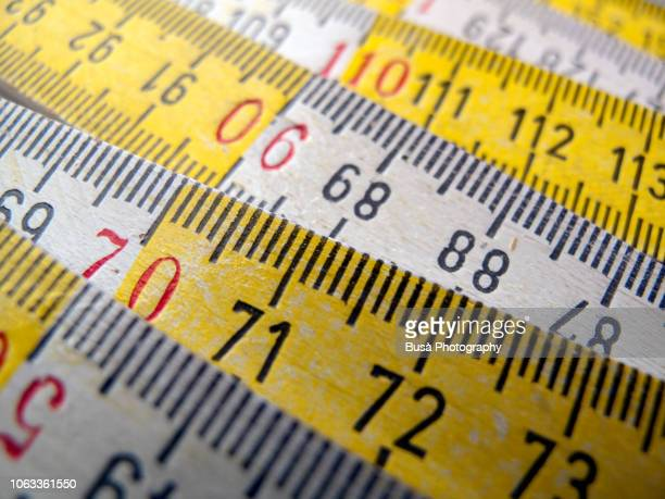 close-up of wooden white and yellow ruler - medir imagens e fotografias de stock