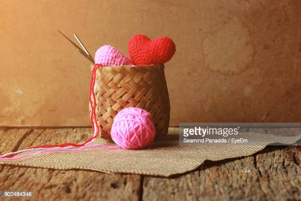 Close-Up Of Wool In Wicker Basket On Table
