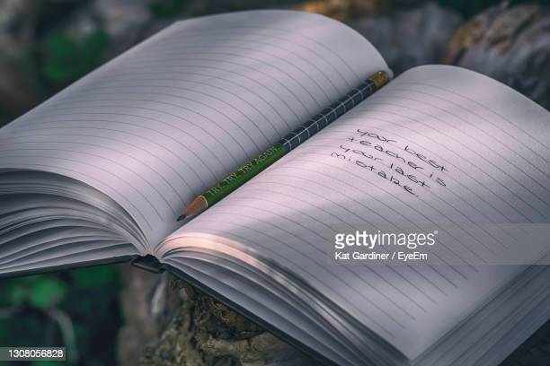 close-up of words in a book - try scoring stock pictures, royalty-free photos & images