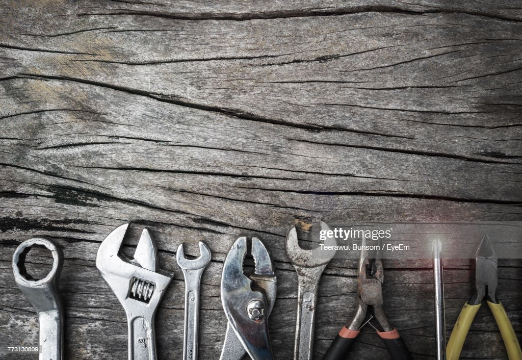 Close-Up Of Work Tools On Wooden Table : Photo