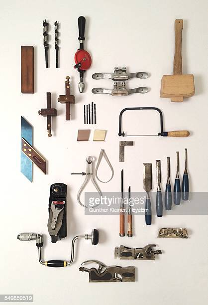 Close-Up Of Work Tools Over White Background