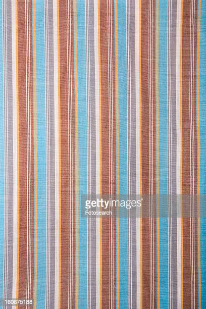 Close-up of woven vintage fabric with blue and brown stripes on cotton