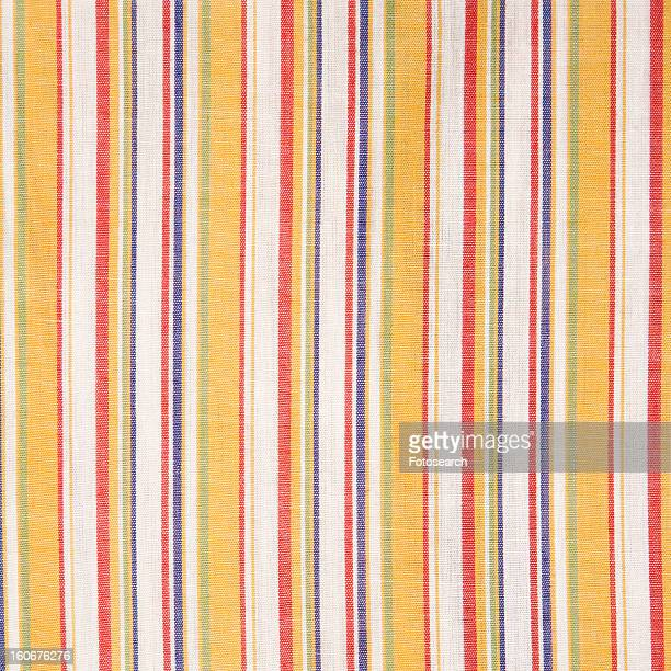 Close-up of woven vintage fabric with colorful stripes on cotton