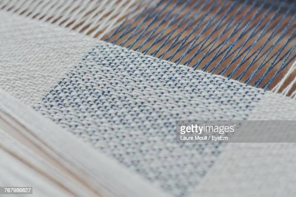 close-up of woven yarn in factory - loom stock pictures, royalty-free photos & images