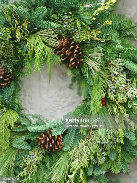 Close-Up Of Wreaths On Wall During Christmas