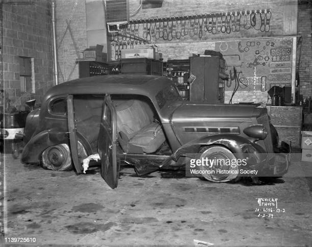 Close-up of wrecked Packard sedan in garage, Madison, Wisconsin, January 2, 1939.