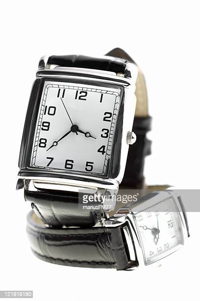 Close-up of wrist watches with square dial plates