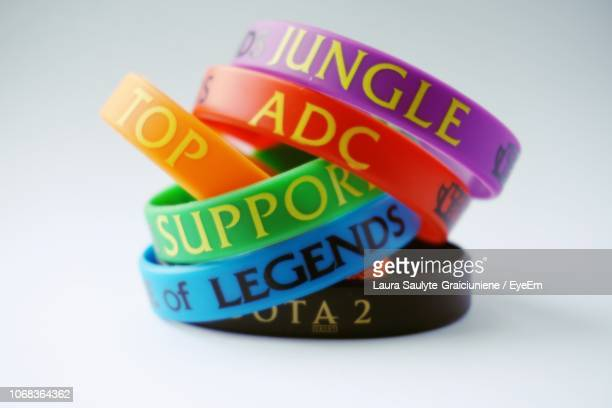 close-up of wristbands against white background - brazalete pulsera fotografías e imágenes de stock