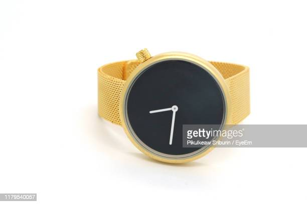 close-up of wristwatch against white background - wristwatch stock pictures, royalty-free photos & images