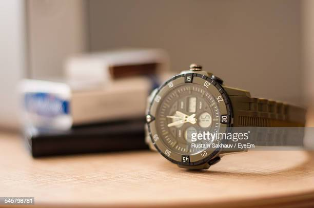 Close-Up Of Wristwatch On Table At Home