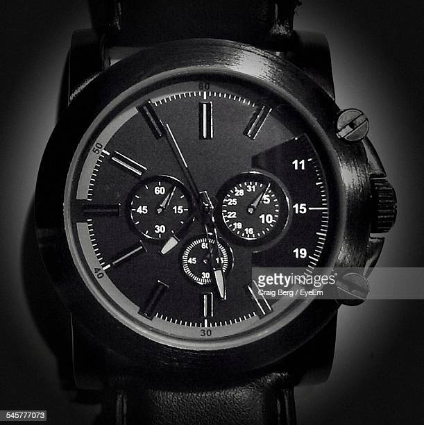 Close-Up Of Wristwatch Over Plain Background