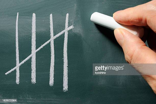 Close-up of writing a counting on blackboard