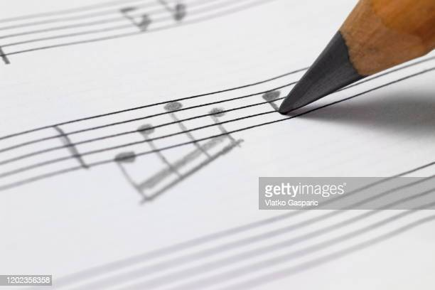 close-up of writing a musical note - composer stock pictures, royalty-free photos & images