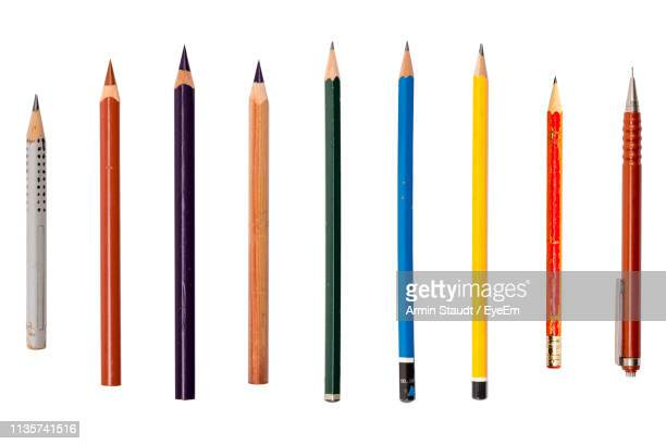 close-up of writing instruments against white background - pencil stock pictures, royalty-free photos & images