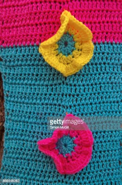 close-up of yarn bombing on a tree - yarn bombing stock photos and pictures
