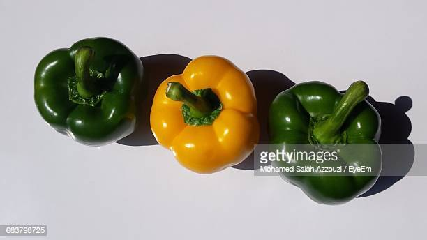 Close-Up Of Yellow And Green Bell Peppers