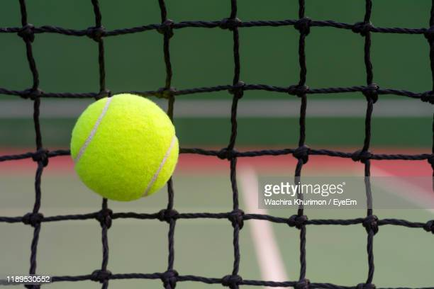 close-up of yellow ball against net - ball stock pictures, royalty-free photos & images