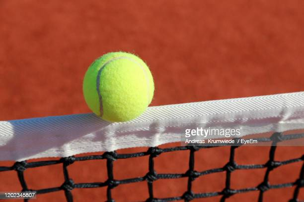 close-up of yellow ball hanging - match point scoring stock pictures, royalty-free photos & images