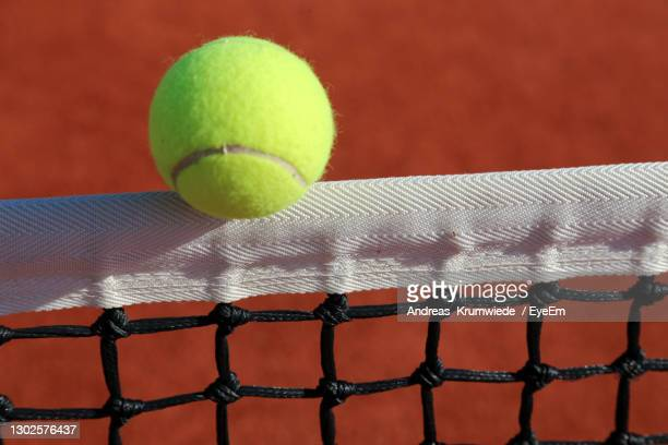 close-up of yellow ball on the net - match point scoring stock pictures, royalty-free photos & images