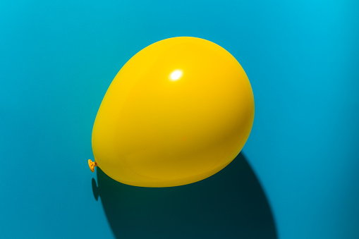 Close-Up Of Yellow Balloon Over Blue Background - gettyimageskorea