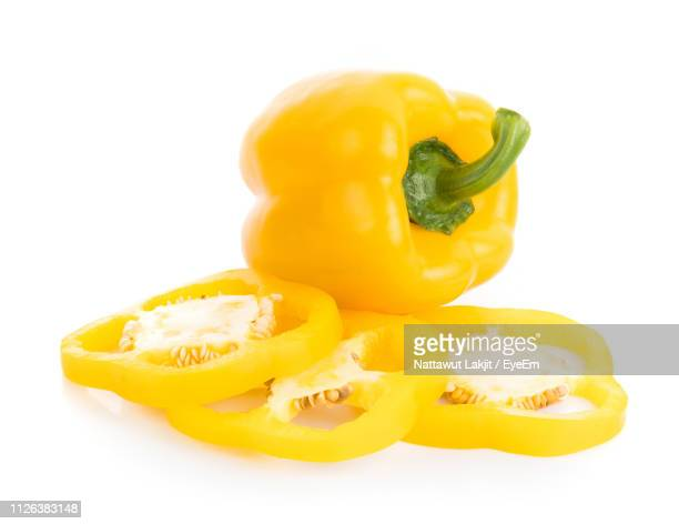close-up of yellow bell pepper against white background - yellow bell pepper stock pictures, royalty-free photos & images