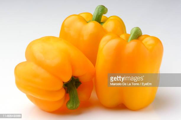 close-up of yellow bell peppers against white background - yellow bell pepper stock pictures, royalty-free photos & images