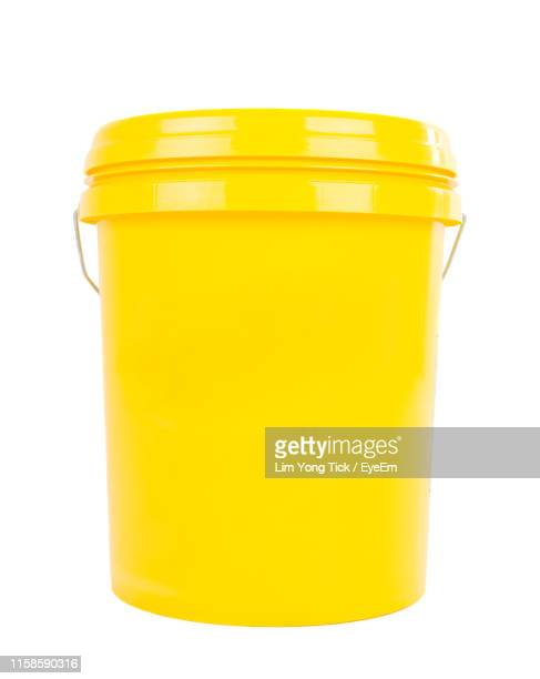 close-up of yellow bucket against white background - bucket stock pictures, royalty-free photos & images