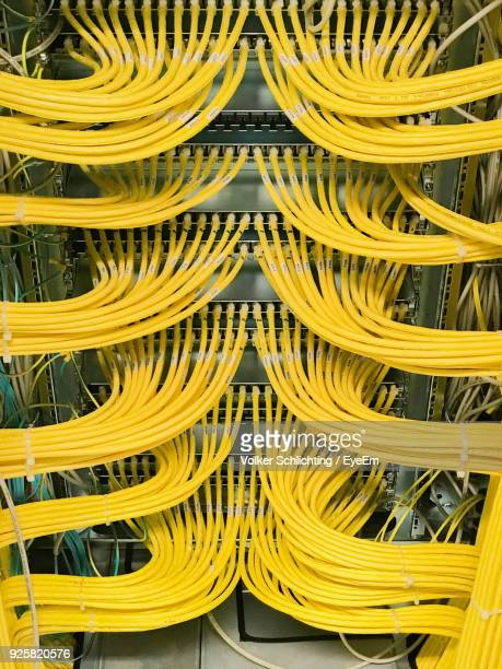 close-up of yellow cables - kabel stock-fotos und bilder