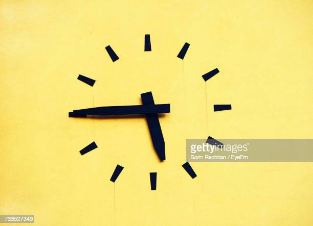close-up of yellow clock - clock stock pictures, royalty-free photos & images
