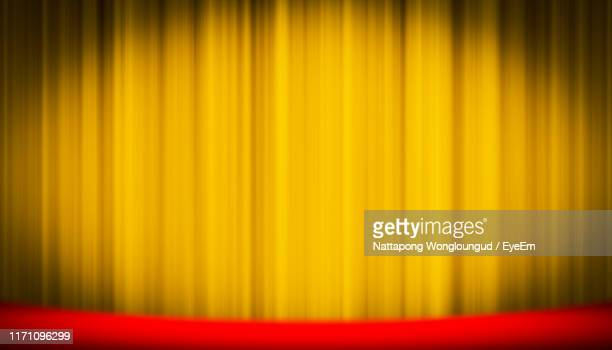 close-up of yellow curtain - curtain stock pictures, royalty-free photos & images
