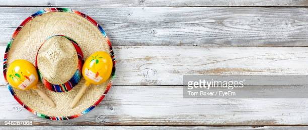 close-up of yellow equipment and hat on wooden table - mois de mai photos et images de collection