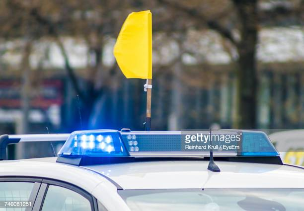 Close-Up Of Yellow Flag On Police Car
