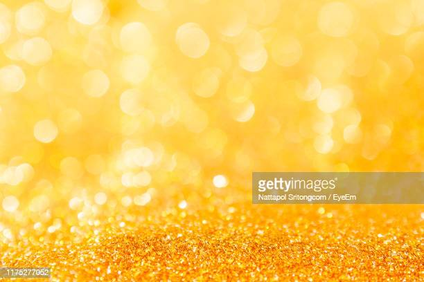 close-up of yellow glitters - yellow stock pictures, royalty-free photos & images